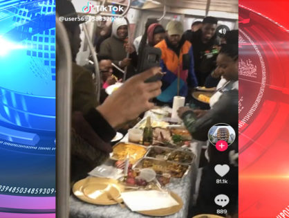 NYC L train straphangers served up a massive Thanksgiving dinner to riders (VIDEO)